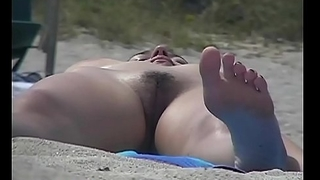Trimmed pussy, small natural boobs, black hair at the nudist shore