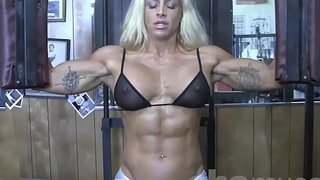 Beauteous Sexy Female Bodybuilder in Twig captivate Top Works Out